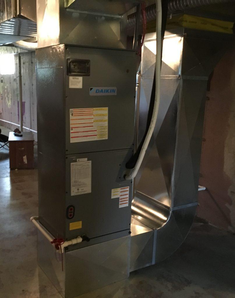 Air handler section of an air source heat pump